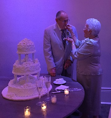 The couple feeding each other cake!